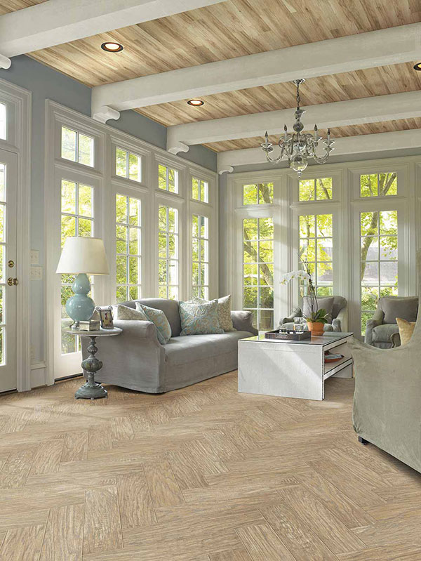 Light wood flooring in neutral contemporary sunroom
